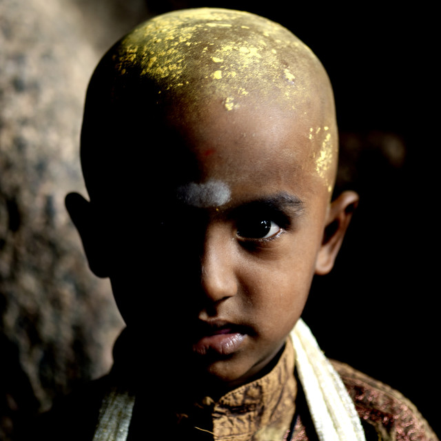 """Young Boy With Shaved Head And Sandalwood Paste On It In A Madurai's Temple,..."" stock image"