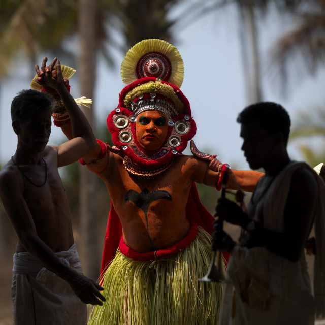 """Theyyam Artist Performing Ritual Attented By Priests, Thalassery, India"" stock image"