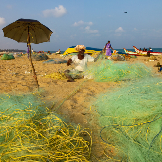 """Mahabalipuram Fishermen On The Beach Mending Nets, India"" stock image"