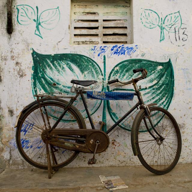 """Rusty Bicyle On Kickstand Parked In A Street, Mahabalipuram, India"" stock image"