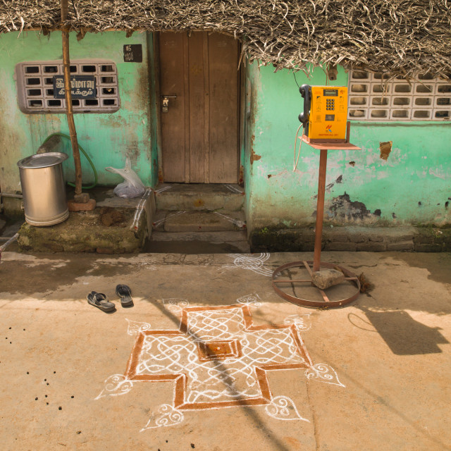 """Kolam Drawned In Front Of House With Green Decrepit Wall And A Public Phone,..."" stock image"