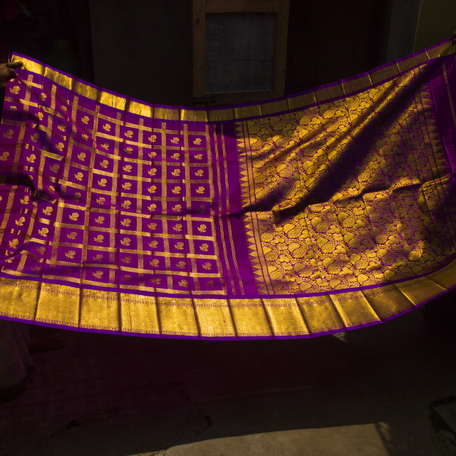 """Women's Hands Folding A Colorful Sari With Gilt, Kumbakonam, India"" stock image"
