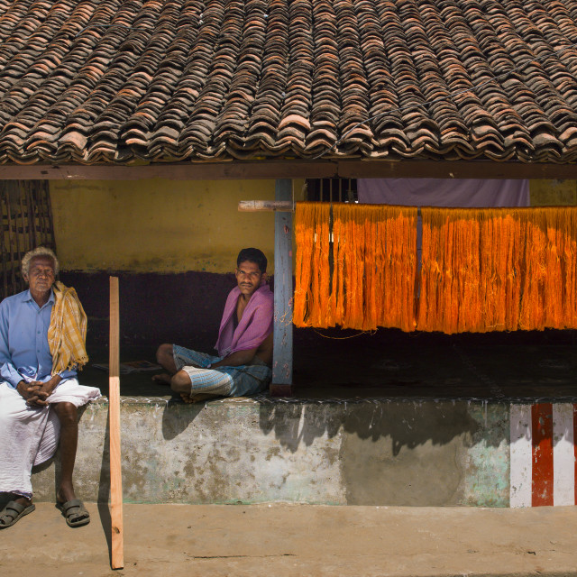 """Men Sitting On The Wall In Front Of Their House With A Tiled Roof,..."" stock image"