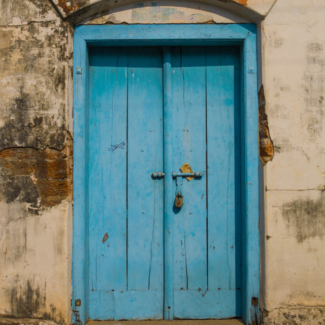 """Old Blue Wooden Door With A Padlock Surrounded By Decrepit Walls, Kochi, India"" stock image"
