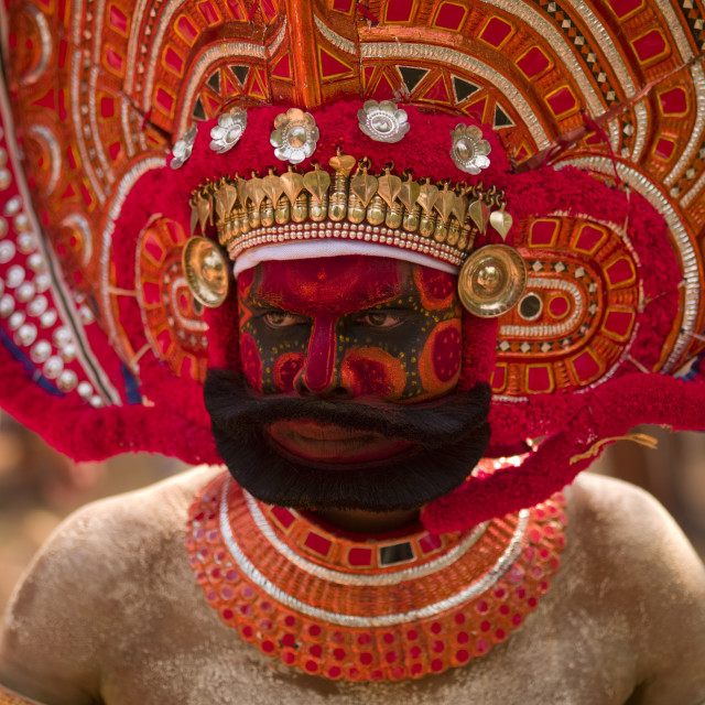 """Man Dressed For Theyyam Ritual With Traditional Painting On His Face,..."" stock image"