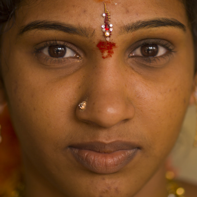 """Close Up Of A Young Indian Woman With Traditional Painting On Her Forehead..."" stock image"