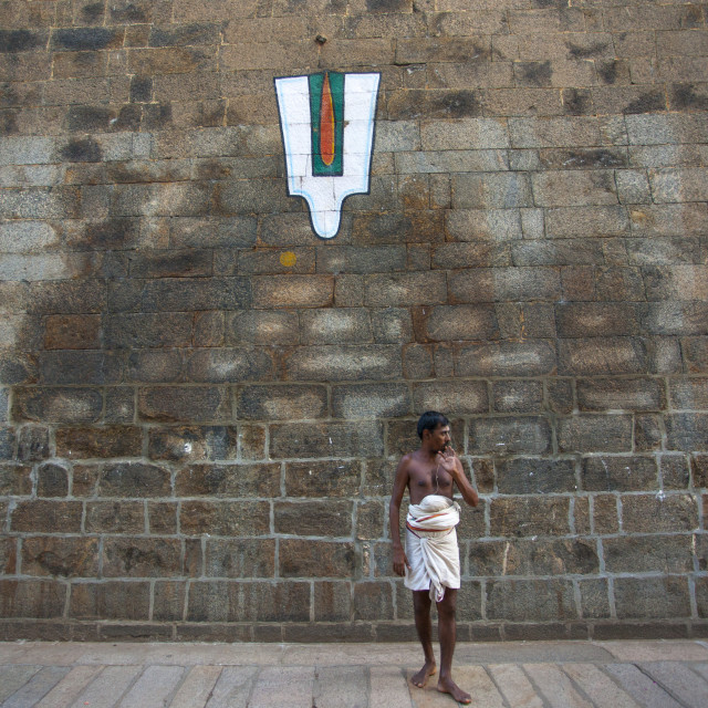"""Priest Posing In Front Of A Vaishnava Tilak Painted On A Wall At The Sri..."" stock image"