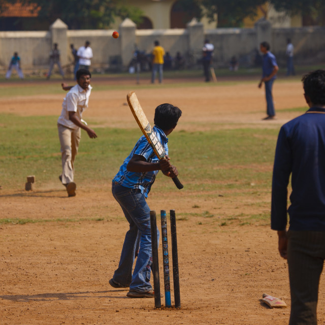 """Group Of Young Men Practicing Cricket On A Public Ground, Kochi, India"" stock image"