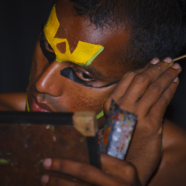 """Kathakali Dancer Applying Make-up, Kochi, India"" stock image"