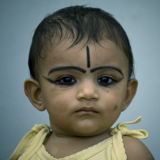 """Baby With Khôl And Protection Sign On The Forehead, Kochi, India"" stock image"