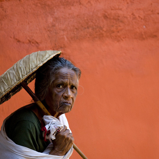 """Old Pilgrim Woman Under The Protection Of An Umbrella Going To A Temple,..."" stock image"