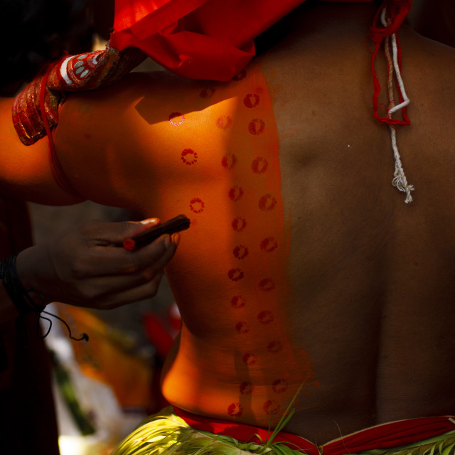 """Theyyam Artist Having Make Up Applied On His Back, Thalassery, India"" stock image"
