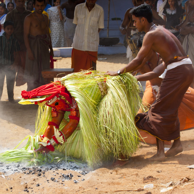 """Theyyam Artist Performing Ritual With Leafs And Ashes In Front Of The..."" stock image"