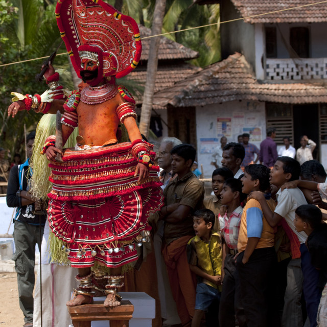 """Theyyam Dancers On Stools Performing Theyyam Ritual Among A Impressed..."" stock image"