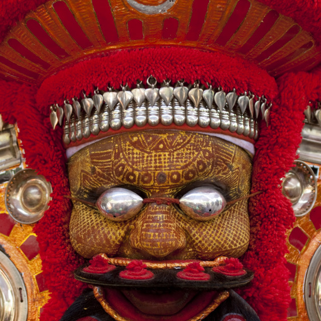 """Man Dressed For Theyyam Ceremony With Traditional Painting On His Face And A..."" stock image"
