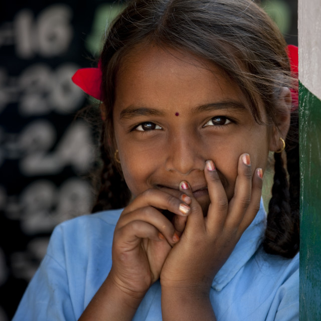 """""""Schoolgirl With Bunches Leaning Against A Wall, Mysore, India"""" stock image"""