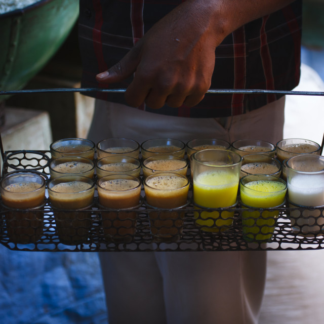 """Man Holding A Basket Full Of Milk Tea Drinks, Mysore, India"" stock image"
