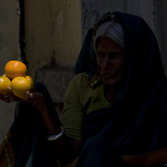 """Orange Seller On Mysore Market, India"" stock image"