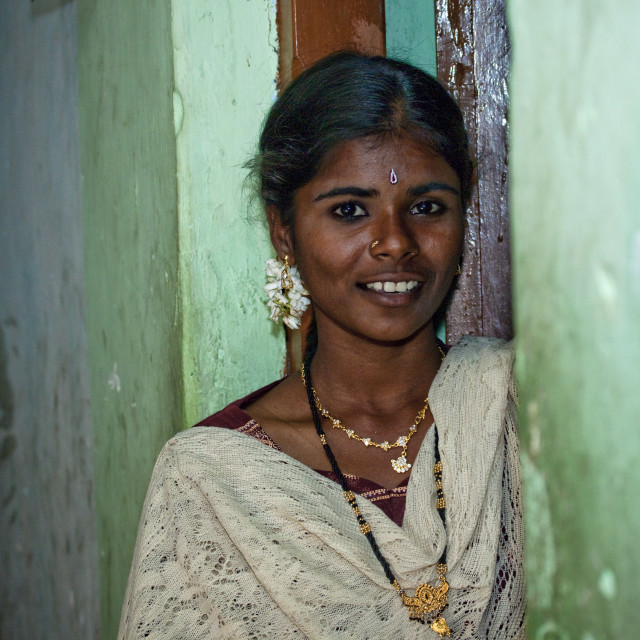 """Smiling Midadult Woman With Flower Earring On The Doorstep, Kumbakonam, India"" stock image"