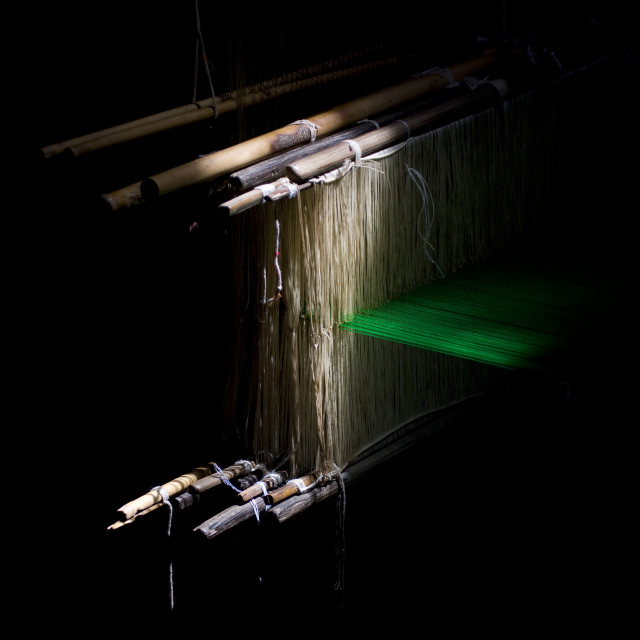 """Traditional Wooden Weaving Loom In The Shadows In Motion With Green Yarn,..."" stock image"