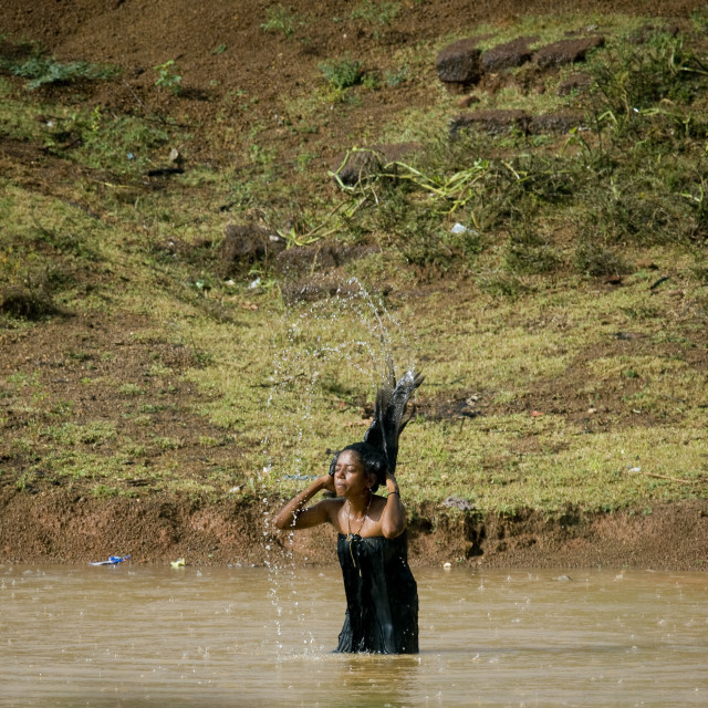 """Woman Washing Her Hair In A Lake, Kanadukathan Chettinad, India"" stock image"