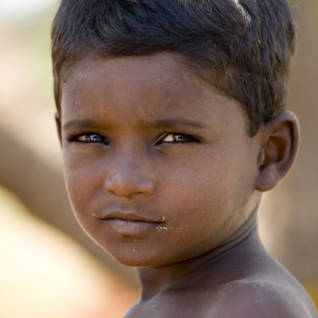 """Little Boy With Crumbs Around His Mouth, Madurai, India"" stock image"