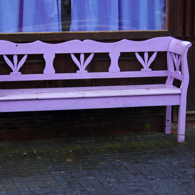 """Purple bench in the rain"" stock image"