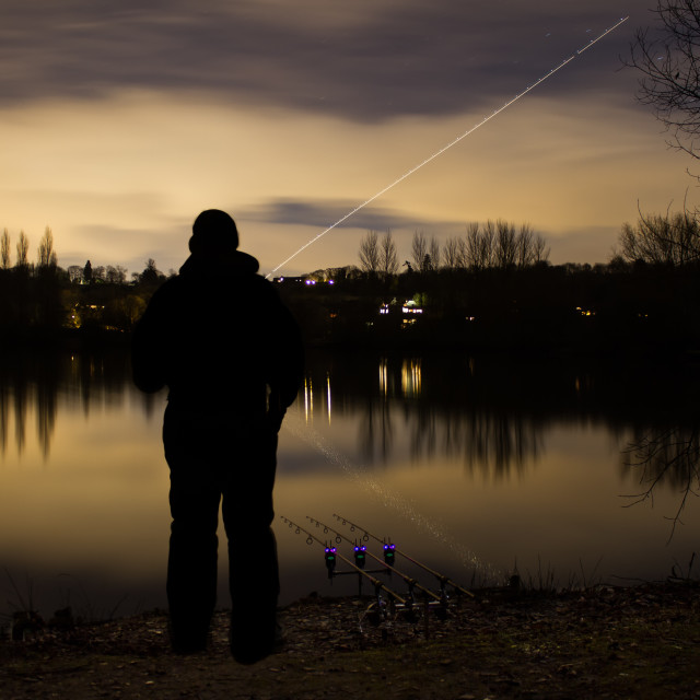 """Carp Fishing Angling at Night with illuminated Alarms"" stock image"