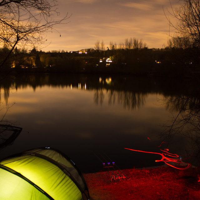 """Carp Fishing at Night with illuminated Bivvy"" stock image"