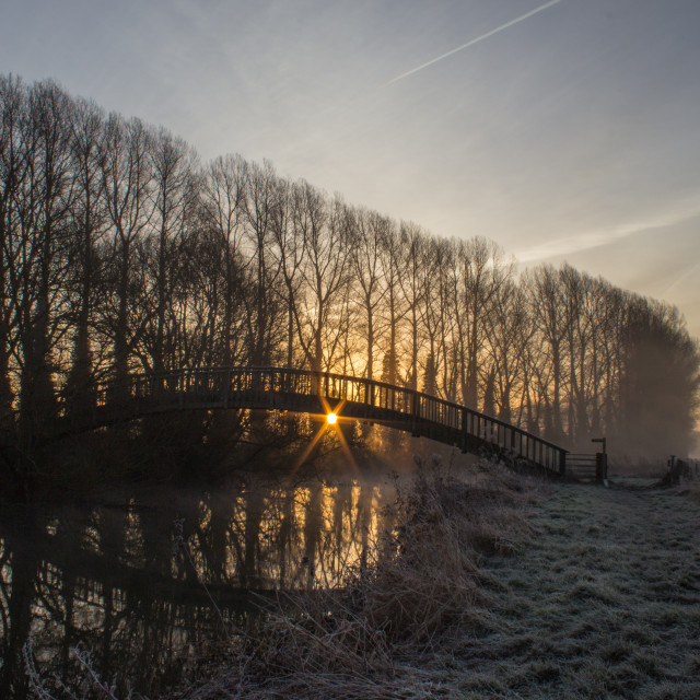 """Wooden Footbrige at sunrise over River Thames"" stock image"