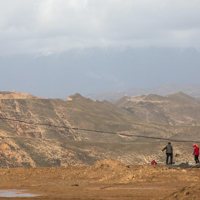 """Tibetan workers in a field, Qinghai Province, Wayaotai, China"" stock image"
