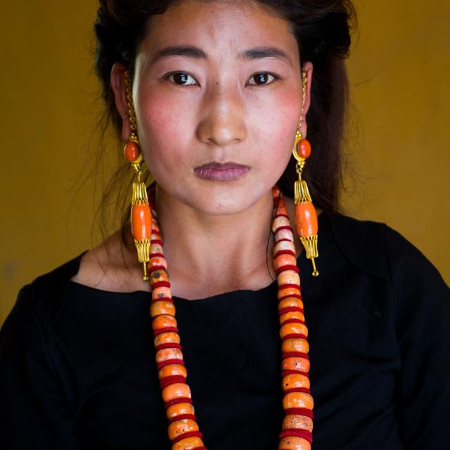 """Portrait of a tibetan woman with a huge necklace, Qinghai province, Tsekhog,..."" stock image"