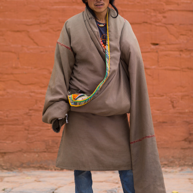 """""""Portrait of a tibetan man wearing a coat with very long sleeves to protect..."""" stock image"""