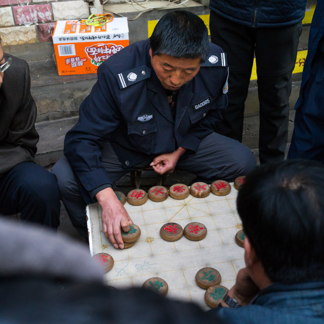"""""""Group of people playing xiangqi chinese chess in the street, Gansu province,..."""" stock image"""