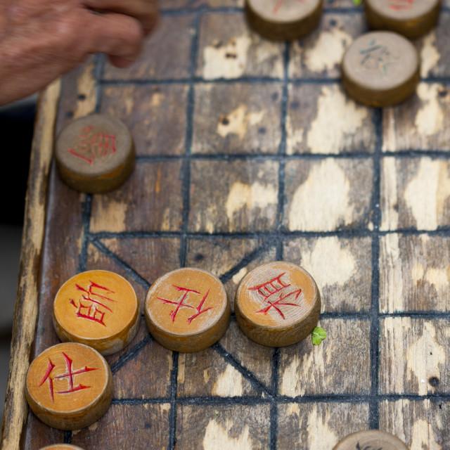 """Man Playing Chinese Chess, Beijing, China"" stock image"