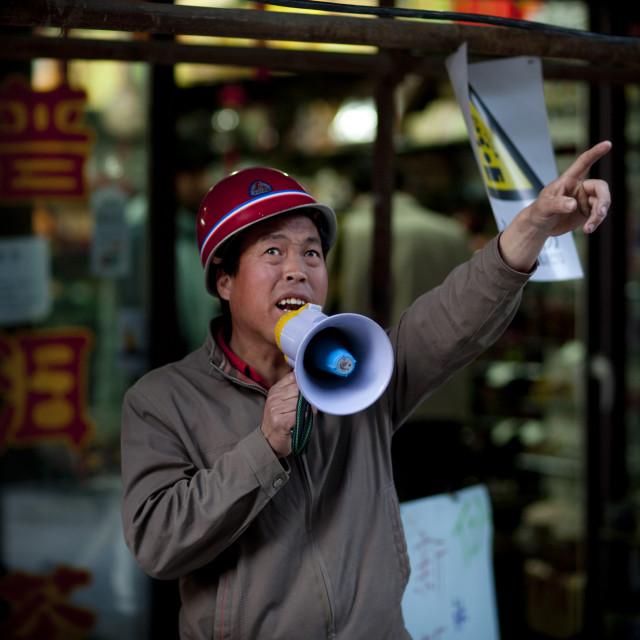 """Seller Shouting In A Loudspeaker, Beijing China"" stock image"
