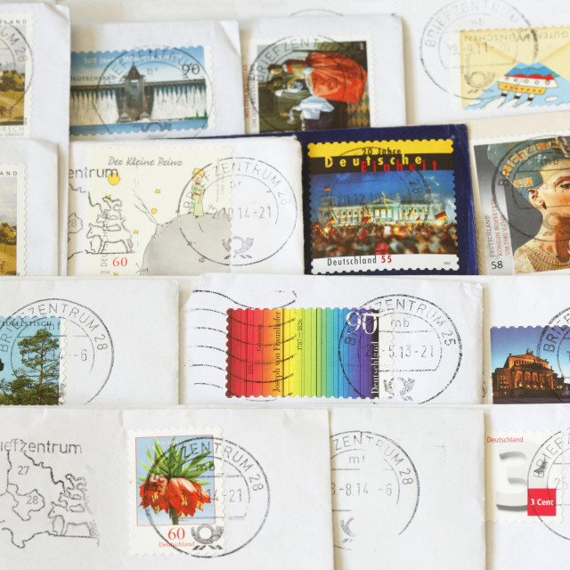 """Colorful German stamped Postage Stamps"" stock image"
