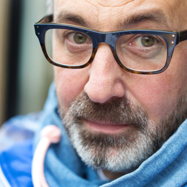 """""""Middle aged man with glasses, beard and modern clothes"""" stock image"""