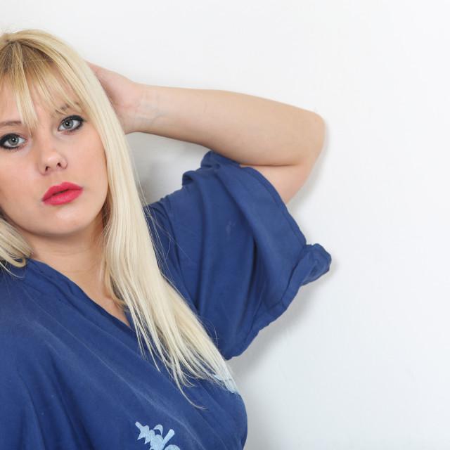 """Portrait of blond caucasian woman dressed in blue kimono"" stock image"