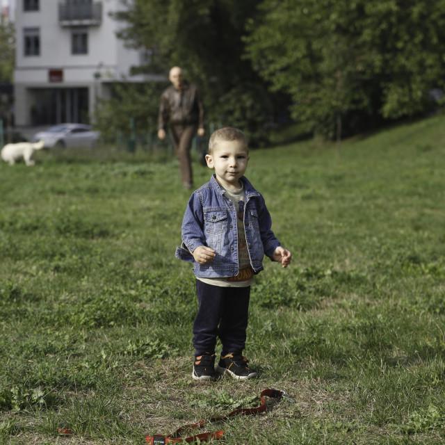 """""""Portrait of little boy walking in park"""" stock image"""