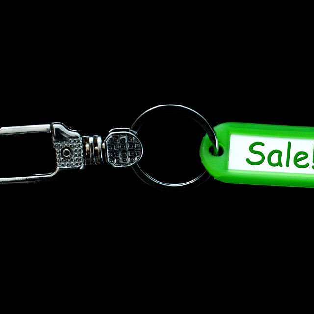 """Key holder and green label holder with text,sale,"" stock image"