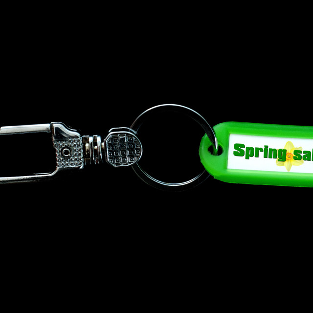 """Key holder and green label holder with text,spring sale"" stock image"