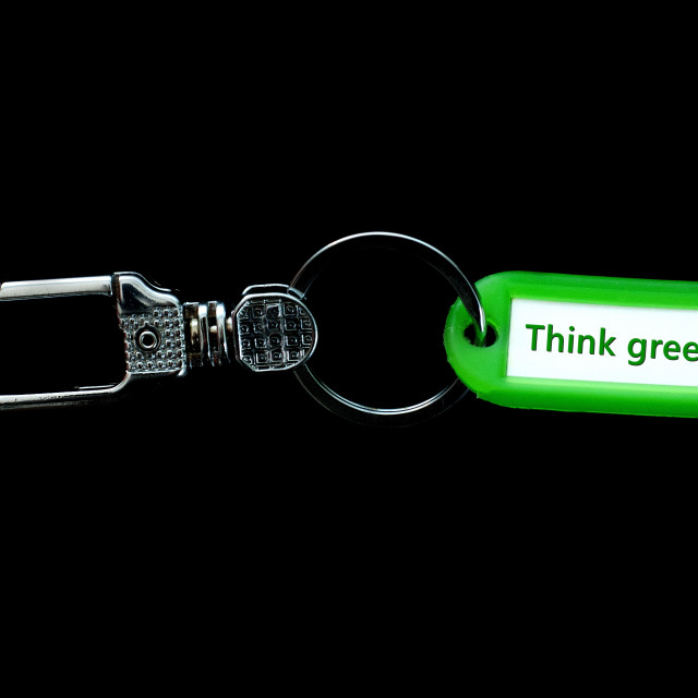 """Key holder and green label holder with text,think green"" stock image"