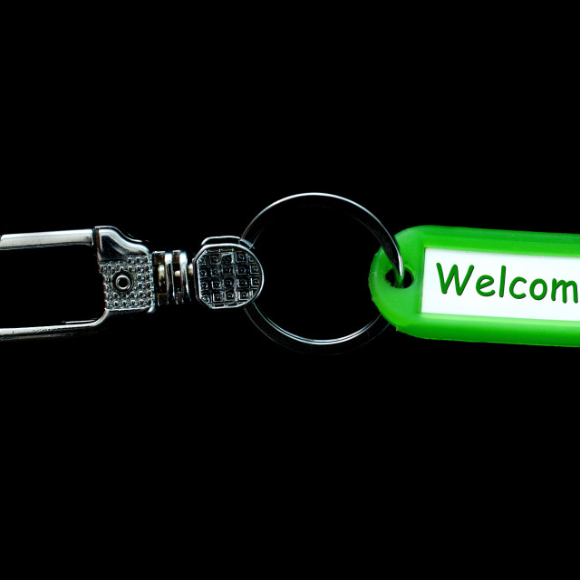 """Key holder and green label holder with text,welcome"" stock image"