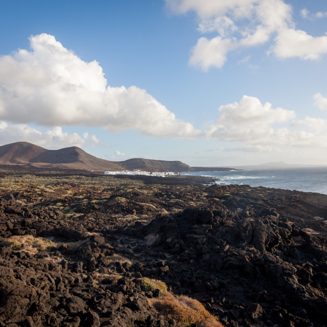 """A view of El Golfo town on Lanzarote near the Timanfaya national"" stock image"