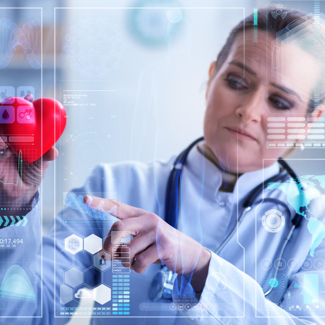 """""""Woman doctor in telemedicine cardiology concept"""" stock image"""