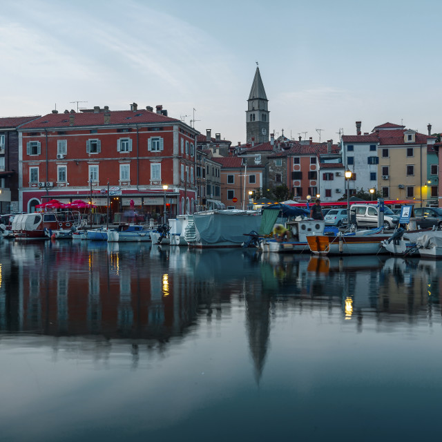 """""""Evening cityscape of old fishing town Isola"""" stock image"""