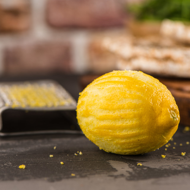 """Lemon zest on kitchen countertop"" stock image"
