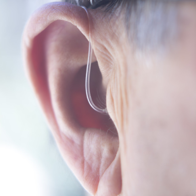 """Hearing aid in ear"" stock image"