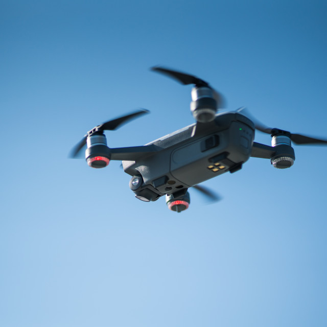 """""""Mini drone flying in the sky"""" stock image"""